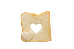 Heart shaped hole in a slice of bread isolated Royalty Free Stock Image