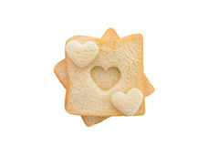Heart shaped hole in a slice of bread isolated Stock Image
