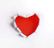 Heart shaped hole in white paper Stock Photos
