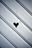 Heart shaped hole in wooden shutter. Single shutter with diagonal plates. Heart shaped hole in the middle Stock Photo