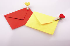 Heart shaped icons attached to colorful envelops Royalty Free Stock Images