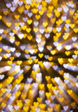 Heart-shaped lights. Yellow and white Heart-shaped illuminations Royalty Free Stock Photo