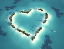 Heart shaped island. Aerial view of heart shaped island with yacht as concept for romantic vacation Royalty Free Stock Images