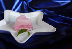 Heart shaped jelly in star shaped plate Royalty Free Stock Photography