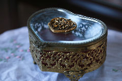 Heart shaped jewelry box. Glass and golden heart shaped jewelry box Royalty Free Stock Photo