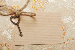 Heart shaped key on a paper card Stock Photography