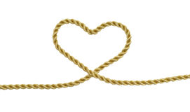 Heart. Shaped knot on a gold rope isolated Royalty Free Stock Photo