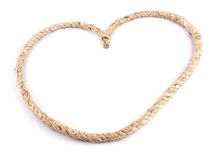Heart Shaped Knot on a Jute rope on white background Stock Photo