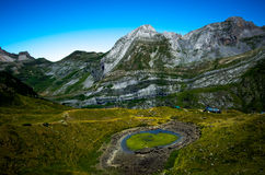 Heart shaped lake in the mountains of Pyrenees, France Royalty Free Stock Photos