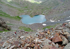 Heart shaped lake in the mountains Stock Images
