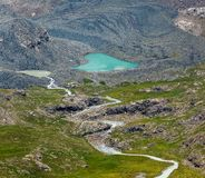 Heart-shaped lake and river flowing from glacier Royalty Free Stock Image