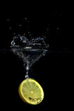 Heart shaped lemon splash Stock Images