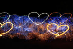 Heart shaped light trails. On a black background Stock Image
