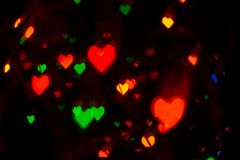 Heart shaped lights background stock photos
