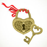Heart shaped lock and key to it Stock Photo