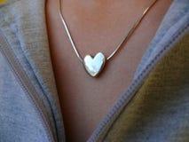 Heart-shaped locket Stock Images