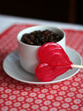 Heart shaped lollipop. A heart shaped lollipop and a cup of coffee Royalty Free Stock Photography