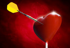 Heart-shaped lollipop hit by an arrow Royalty Free Stock Image