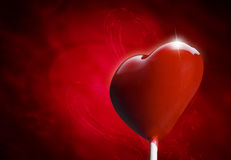 Heart-shaped lollipop hit by an arrow Royalty Free Stock Photography
