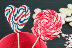 Heart shaped lollipop and a round lollipop Stock Images