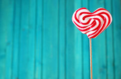 Heart shaped lollipop for Valentine's Day with turquoise backgro Stock Photo