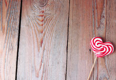 Heart shaped lollipop for Valentine's Day with wooden background Stock Images