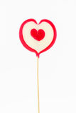 Heart shaped lollipop  on white background Royalty Free Stock Images