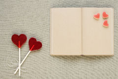 Heart-shaped lollipops, candies and an old diary Royalty Free Stock Images