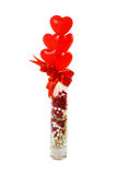 Heart-Shaped Lollipops in a Vase. Five red lollipops in a crystal vase Royalty Free Stock Photos