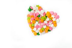 Heart shaped made from colored sprinkles Stock Photography
