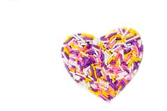 Heart shaped made from colored sprinkles Stock Images