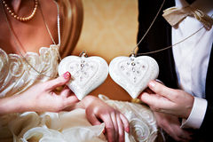 Heart-shaped mascots the bride and groom stock photos