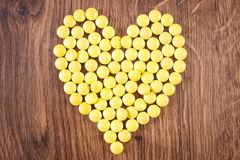 Heart shaped medical pills and capsules, health care concept Royalty Free Stock Photos