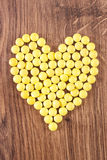 Heart shaped medical pills and capsules, health care concept Stock Photography