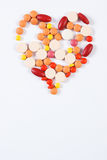 Heart shaped medical pills and capsules on white background, health care concept, copy space for text Stock Photo