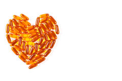 Heart shaped medical pills and capsules on white background, health care concept, copy space for text Royalty Free Stock Images