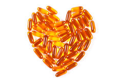 Heart shaped medical pills and capsules on white background, health care concept Royalty Free Stock Image