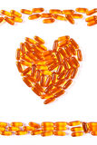 Heart shaped medical pills and capsules on white background, health care concept Royalty Free Stock Images