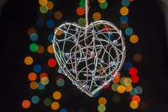 Heart shaped metal cage on bokeh light background. Heart shaped metal cage on a bokeh light background Royalty Free Stock Photography