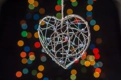 Heart shaped metal cage on bokeh light background. Heart shaped metal cage on a bokeh light background Stock Image