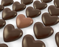 Heart shaped milk chocolate candies Stock Photos