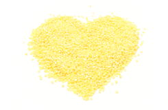 Heart shaped millet groats on white background Royalty Free Stock Image