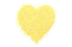 Heart shaped millet groats on white background Stock Photo
