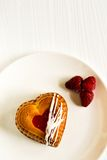 Heart-shaped mini cake with berry Royalty Free Stock Photos