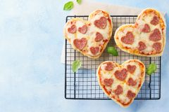 Heart shaped mini pizza. Valentines day romantic menu royalty free stock photos