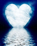 Heart shaped moon reflected in ocean Royalty Free Stock Image