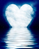 Heart shaped moon reflected in ocean Stock Images