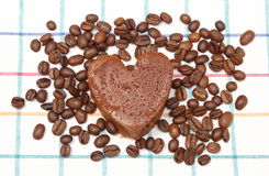 Heart shaped muffin with coffee grains on colorful cloth Royalty Free Stock Image