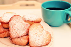 Heart shaped muffins in vintage plate Stock Photography