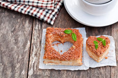 Heart  shaped  napoleon cake with mint on old wooden table Stock Photography